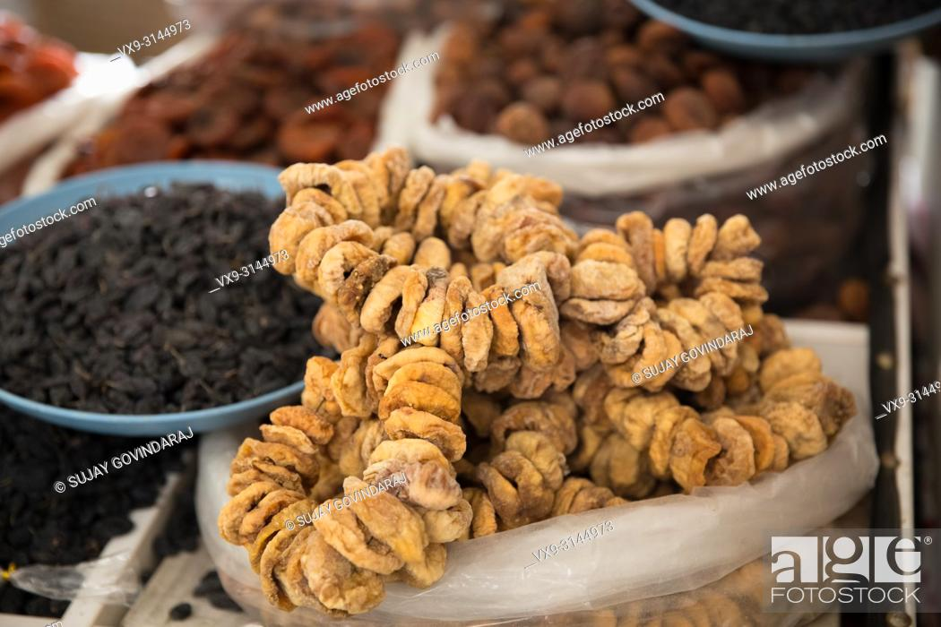 Stock Photo: Various dry fruits like dates, figs, pista, dried grapes, almonds and more.