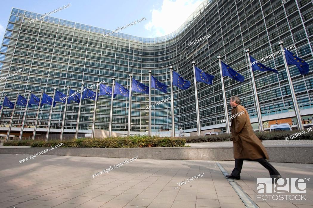 Stock Photo: A man walks next to the Berlaymont building, the European Commission headquarters, in Brussels, Belgium.