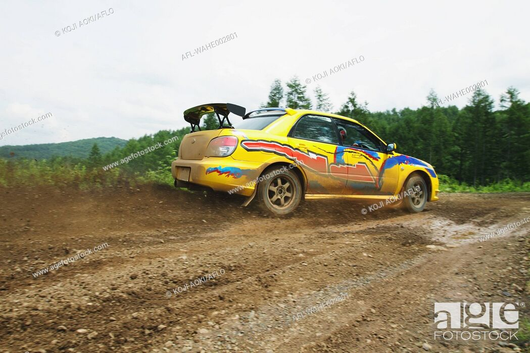 Stock Photo: Rally car racing on dirt track.