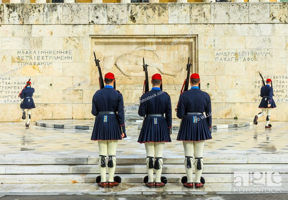 Stock Photo: Changing the Guard Tomb of Unknown Soldiers Syntagma Square in front of Parliament Athens Greece. Soldiers are Evzones of the Presidential Guard.