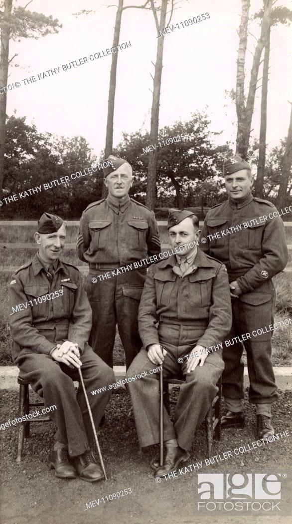 Group photo, four British soldiers (permanent staff) on a