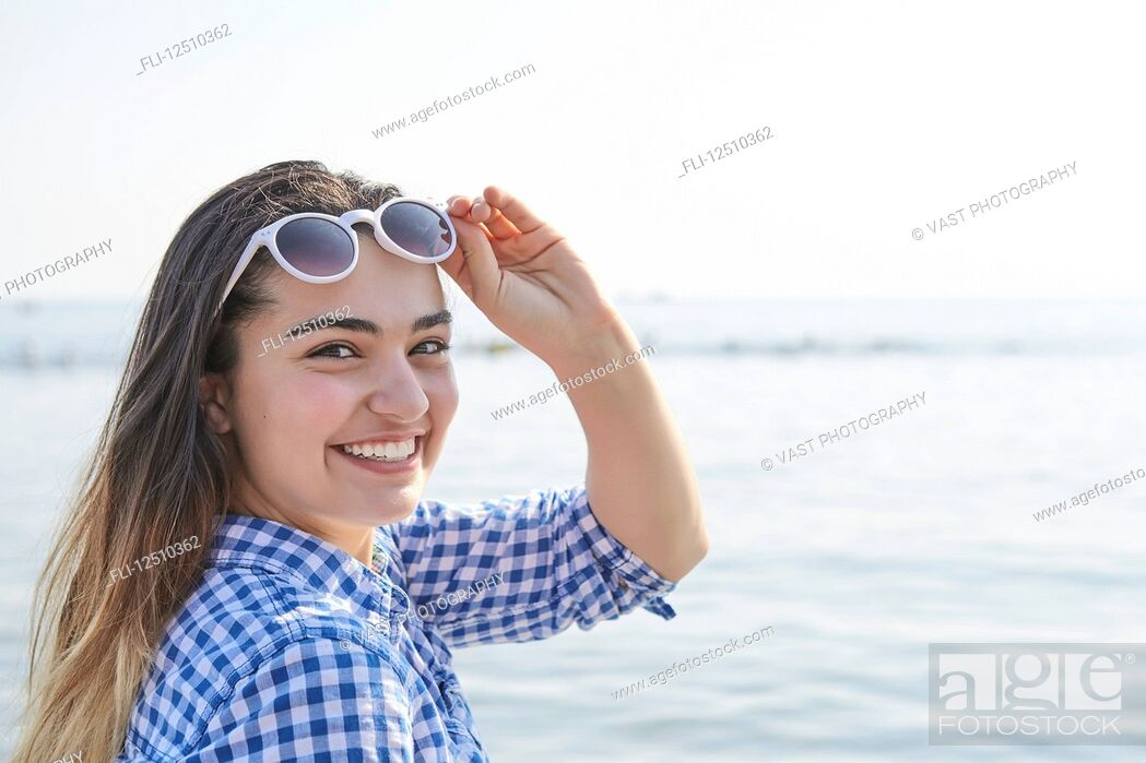 Stock Photo: Portrait of a teenage girl at the water's edge at Woodbine Beach in summer; Toronto, Ontario, Canada.