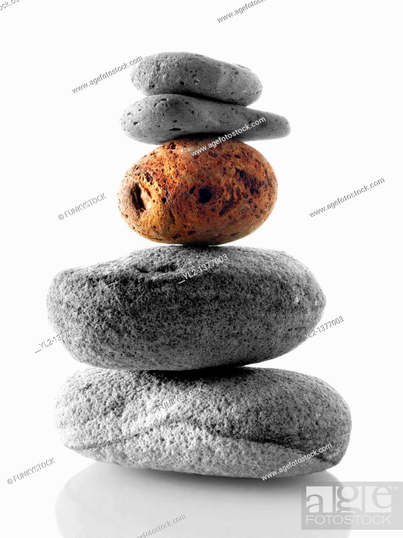 Stock Photo: Stones stacked ontop of each other  Black and white with one coloured stone.