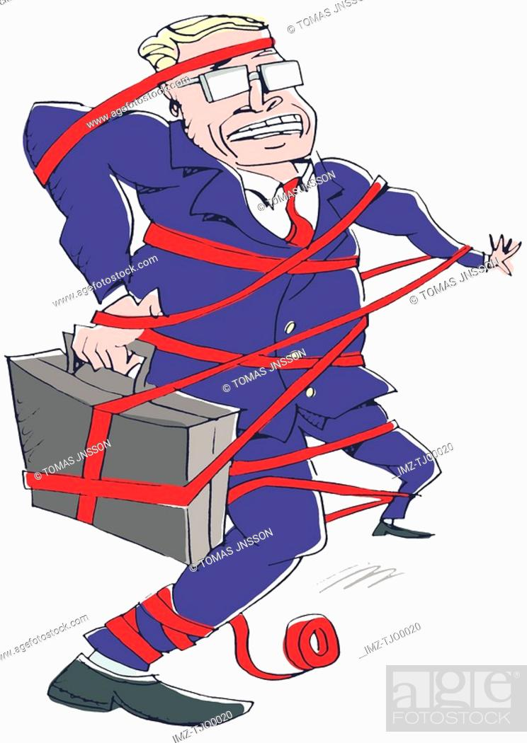 Stock Photo: businessman caught in red tape.