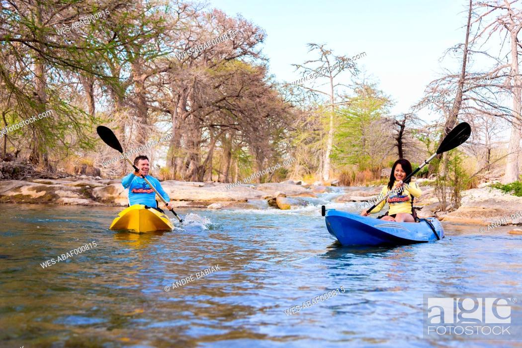 Stock Photo: USA, Texas, Man and woman kayaking on Frio River.