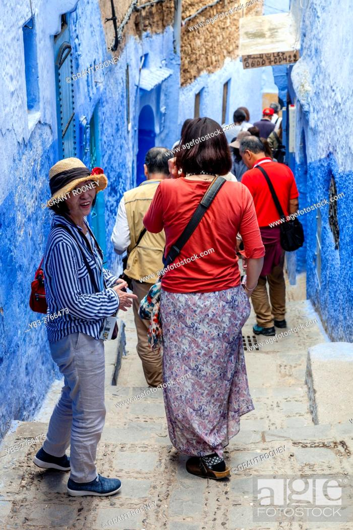 Stock Photo: Chinese Tourists In The Medina, Chefchaouen, Morocco.