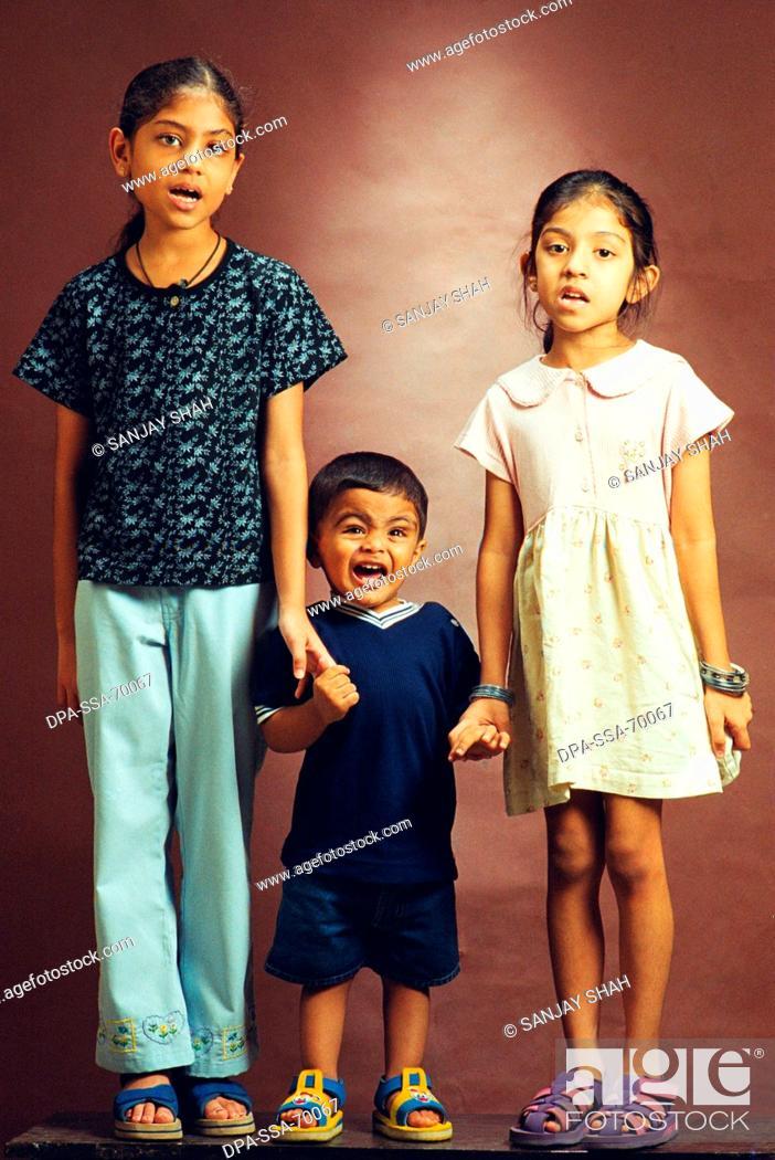Young Indian girls Nami and Disha and young boy Yash, Stock