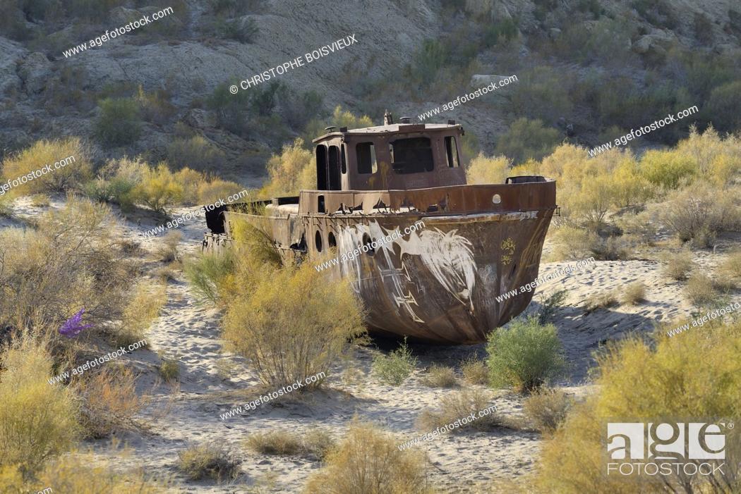 Stock Photo: Uzbekistan, Autonomous republic of Karakalpakstan. . Moynaq, Aral Sea, Rusting fishing boats abandoned after the shrinking of the Aral Sea.