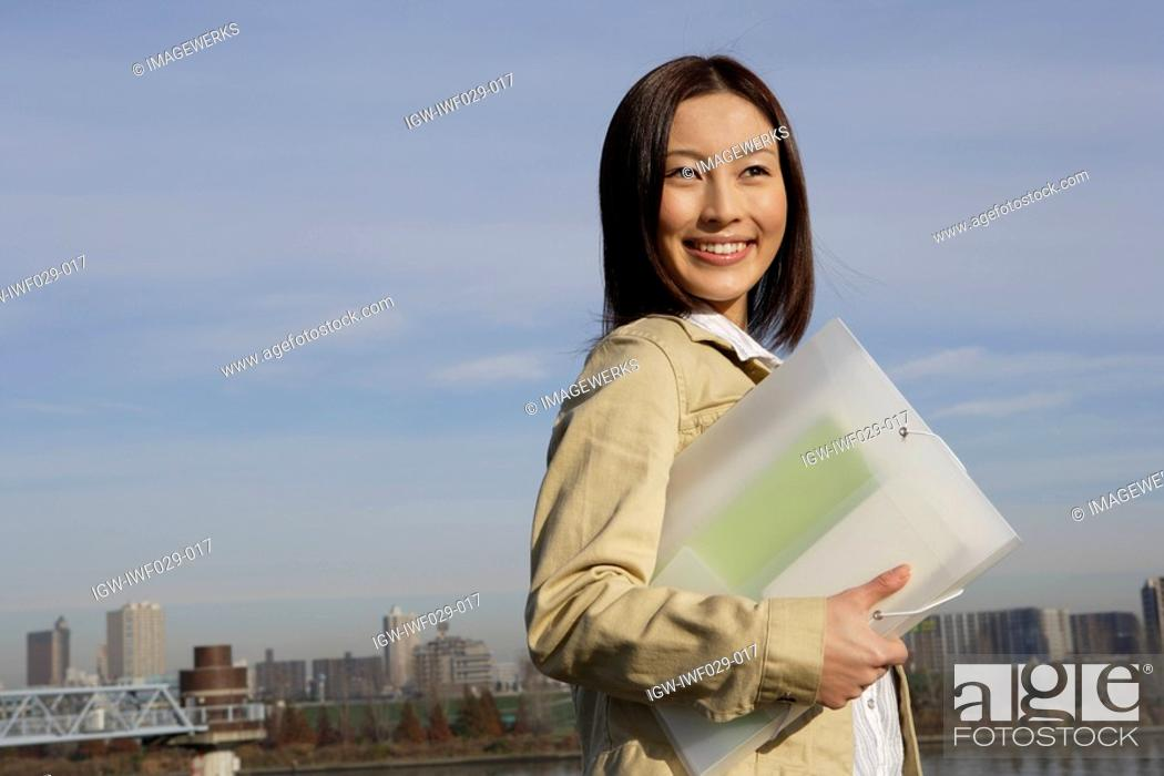 Stock Photo: View of a woman with a folder in her hand.