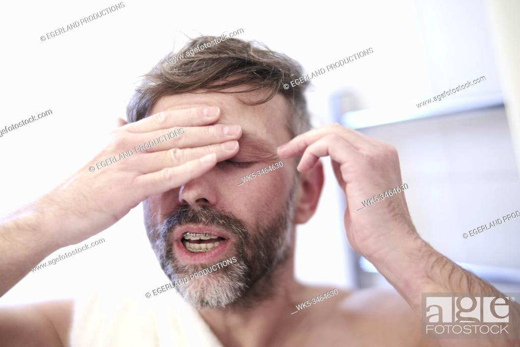 Stock Photo: Close-up of man with headache or hangover.