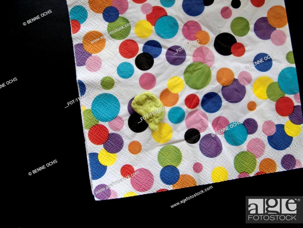 Stock Photo: Chewed gum on a polka dot napkin.