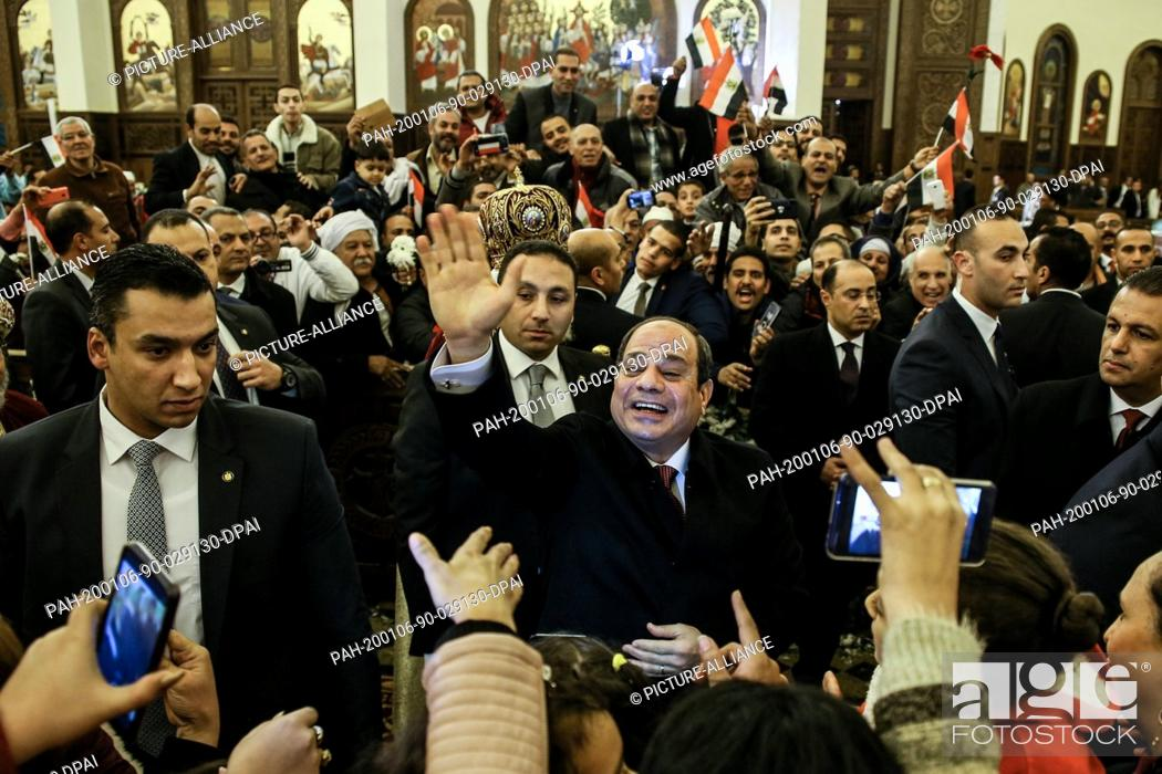 Stock Photo: 06 January 2020, Egypt, Cairo: Egyptian President Abdel Fattah el-Sisi..greets people as he arrives to attend the Coptic Orthodox Christmas eve Mass.