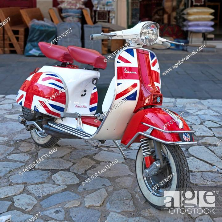 A Piaggio Vespa scooter, painted with the flag and colours