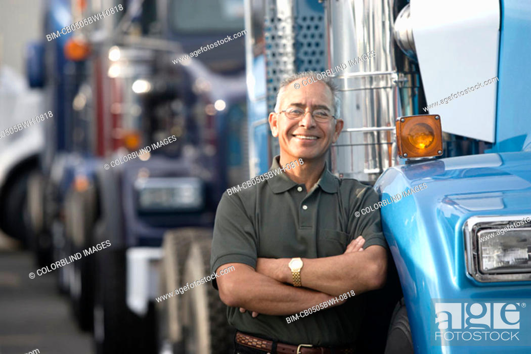Stock Photo: Middle aged man smiling beside his truck.