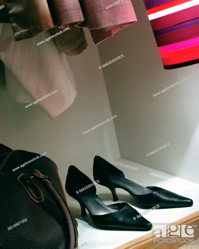 Stock Photo: High heeled shoes in wardrobe.