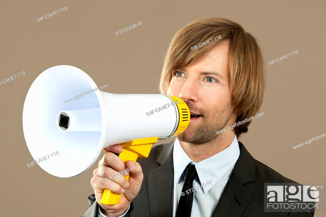 Stock Photo: Businessman holding megaphone.
