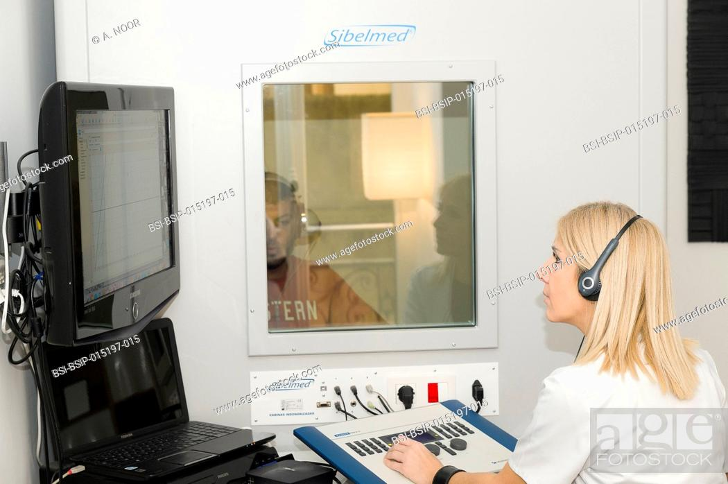 Stock Photo: Reportage on an ENT doctor in Nice, France, treating patients suffering from dizziness. A 37-year old patient during hearing tests in a booth.
