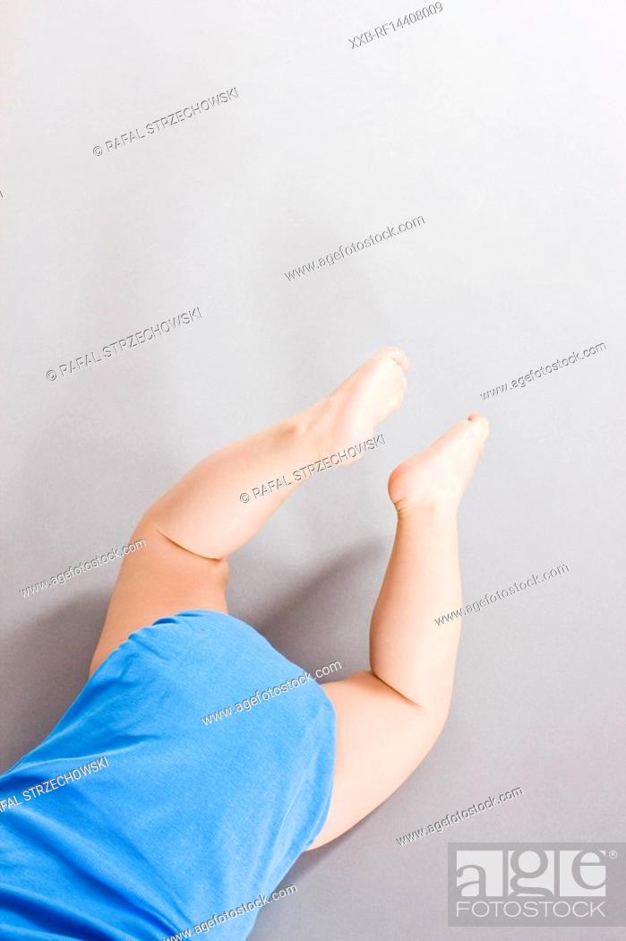 Stock Photo: Baby crawling on floor.