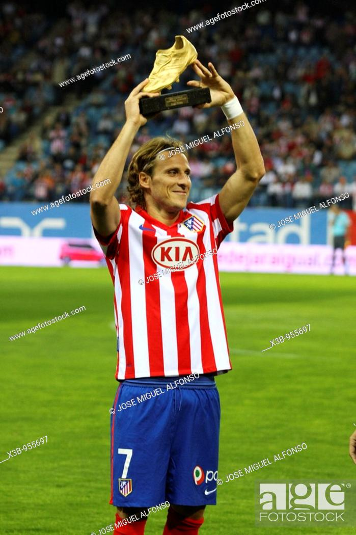 Stock Photo: Diego Forlan, football player of the Atletico de Madrid, offers to his interest the European Golden Boot obtained in the season 2008-09.