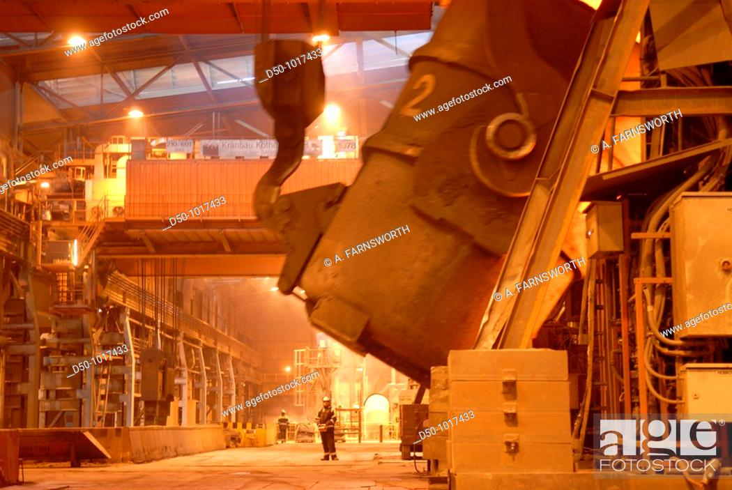 Stock Photo: Man uses remote control to tip a huge vat of molten steel in steel making process, SSAB Swedish Steel Ab, Lulea, Sweden.