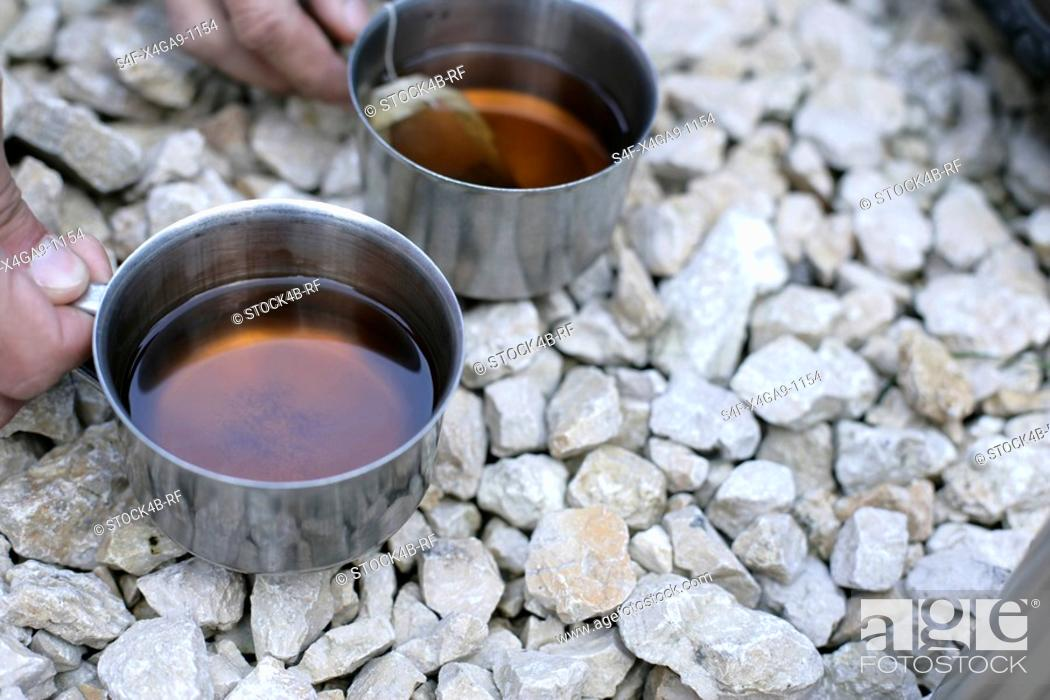 Stock Photo: Two Tin cups with tea.