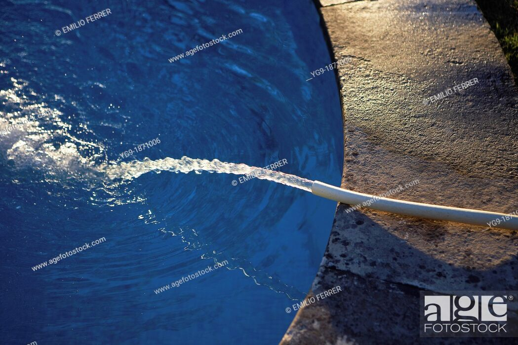 Stock Photo: Filling a pool with a hosepipe.