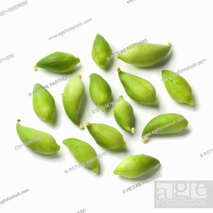 Photo de stock: Organic green heirloom wild cucumbers on white background.