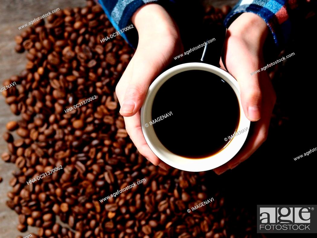 Stock Photo: Hands holding coffee cup.