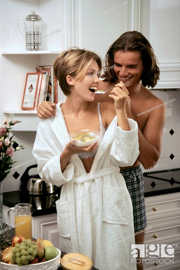 Stock Photo: Couple in kitchen. Healthy breakfast.