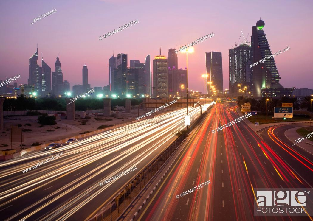 Stock Photo: Busy traffic on Sheikh Zayed Road at dusk in Dubai in United Arab Emirates.