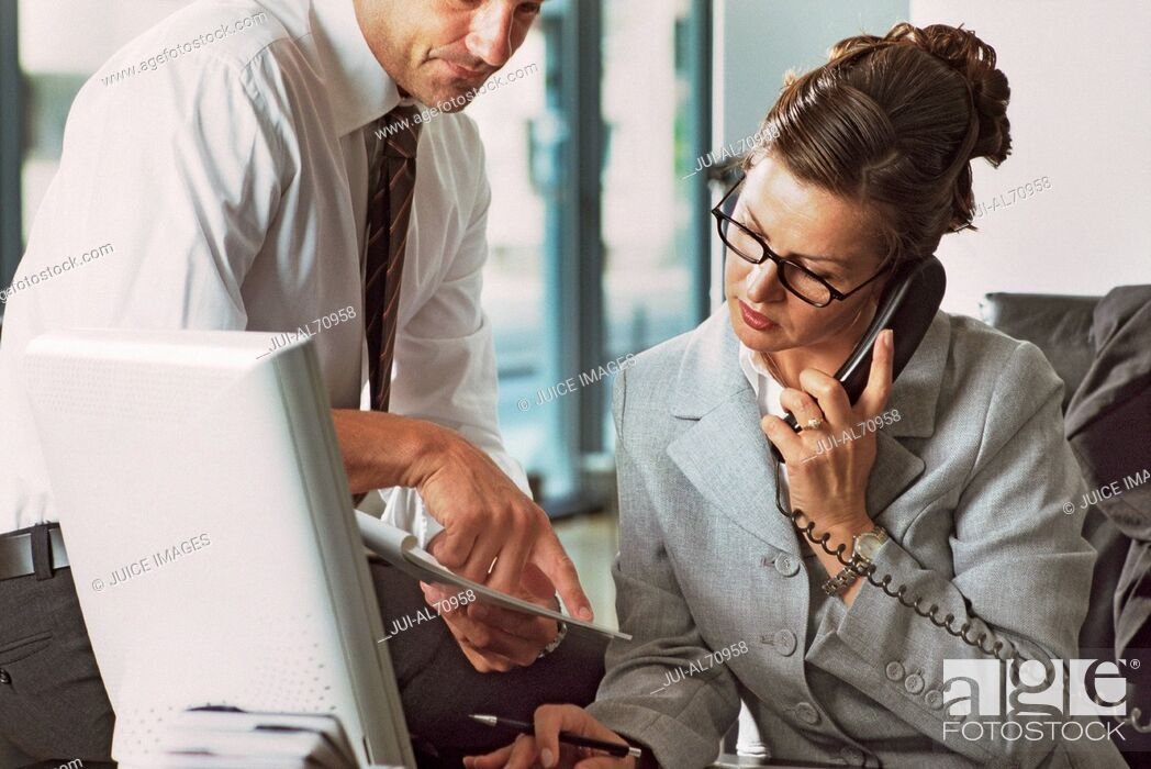 Photo de stock: View of a businesswoman talking on the phone and working.