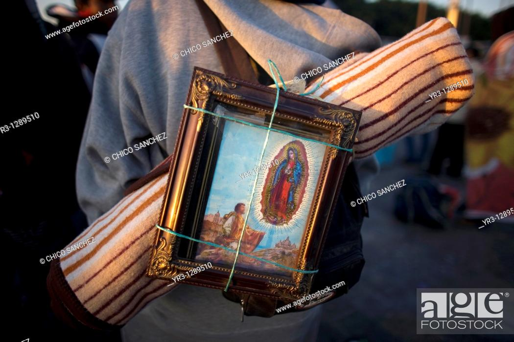 Stock Photo: A pilgrim carries on his back an image of the Our Lady of Guadalupe in Mexico City, December 11, 2010  Hundreds of thousands of Mexican pilgrims converged on.
