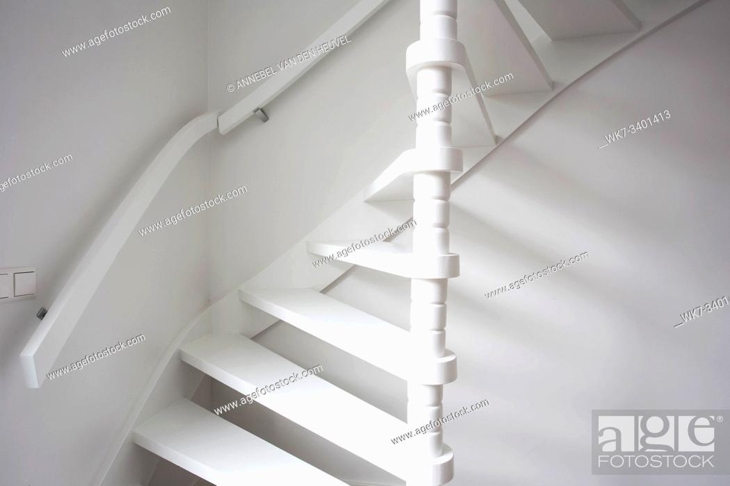 Photo de stock: Stairs in modern white room, white wooden stairs with white wall modern.