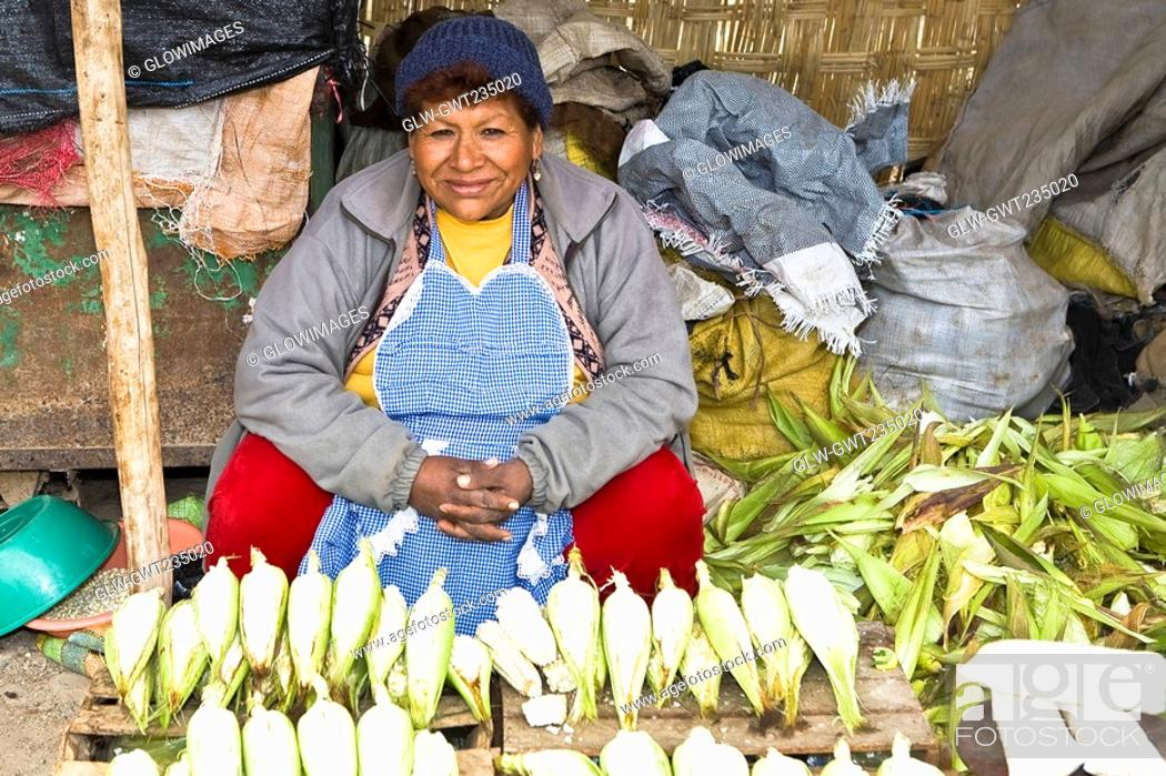 Stock Photo: Portrait of a mature woman sitting at a market stall, Ica, Ica Region, Peru.