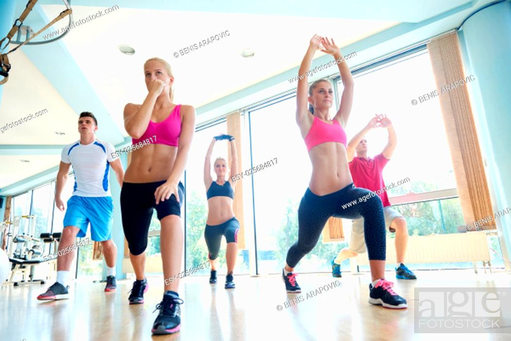 Stock Photo: group of young people working out in a fitness gym.