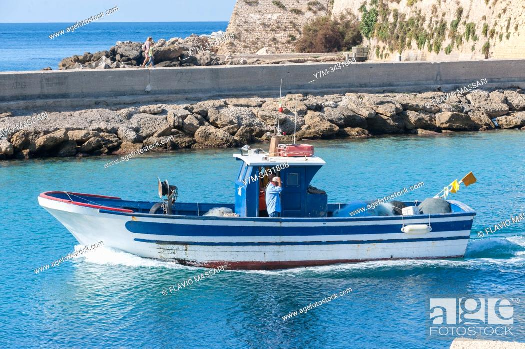 Stock Photo: Small fisher boat in navigation in the Ionian Sea.
