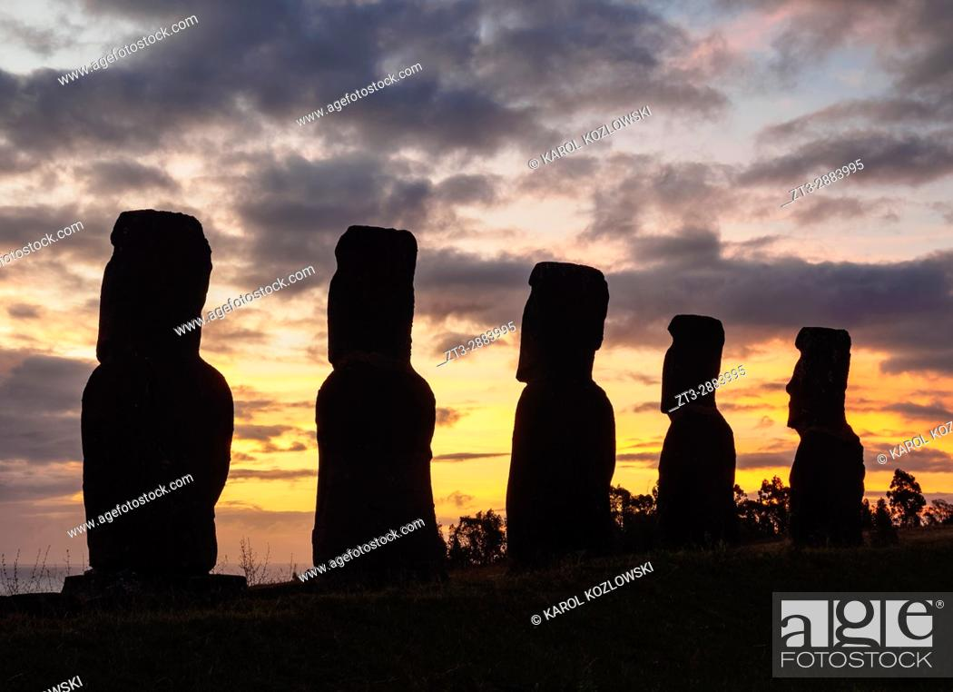 Stock Photo: Moais in Ahu Akivi at sunset, Rapa Nui National Park, Easter Island, Chile.