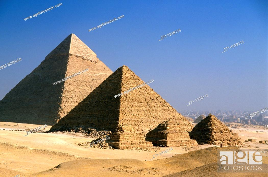 Stock Photo: Khafre's Pyramid (in background) and Menkaure's Pyramid with its subsidiary Queen's Pyramids. Giza, Cairo, Egypt.