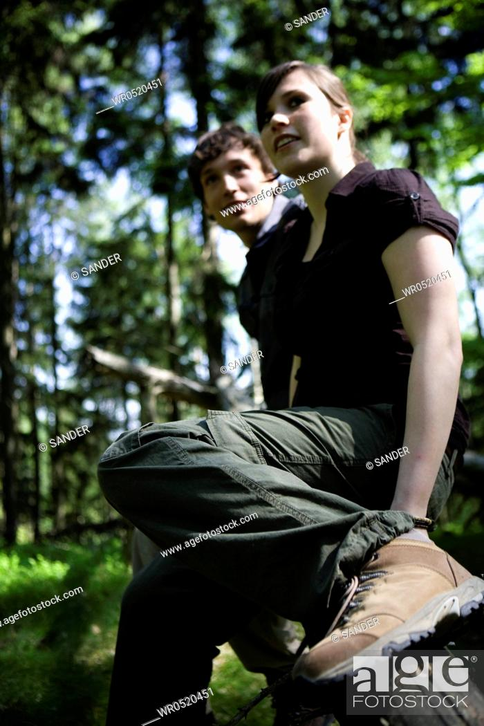 Stock Photo: Young couple sitting in the woods.