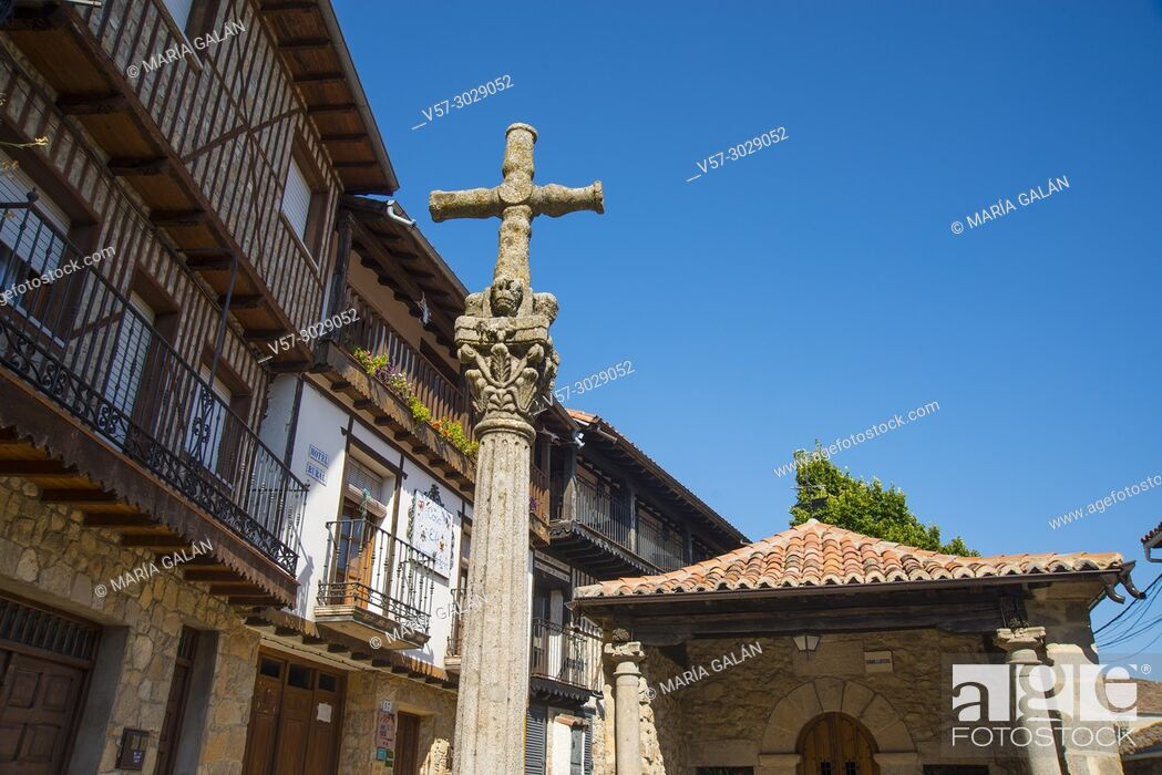 Stock Photo: Stone cross and facades of houses. Mogarraz, Sierra de Francia, Salamanca province, Castilla Leon, Spain.