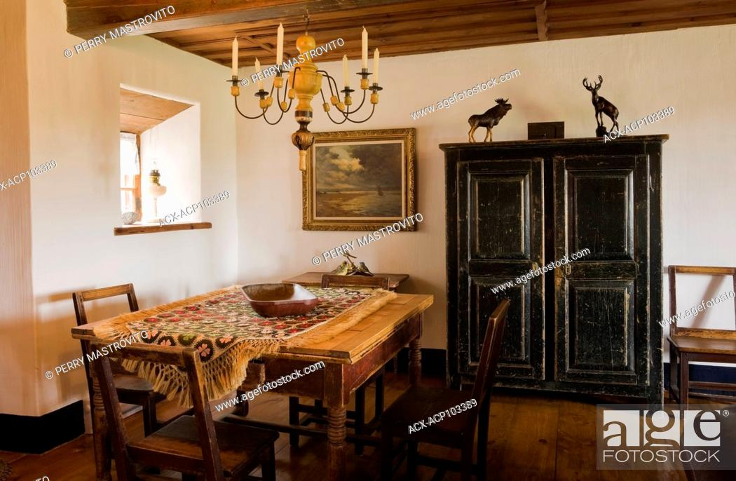 Antique table, chairs and an armoire in the secondary dining ...