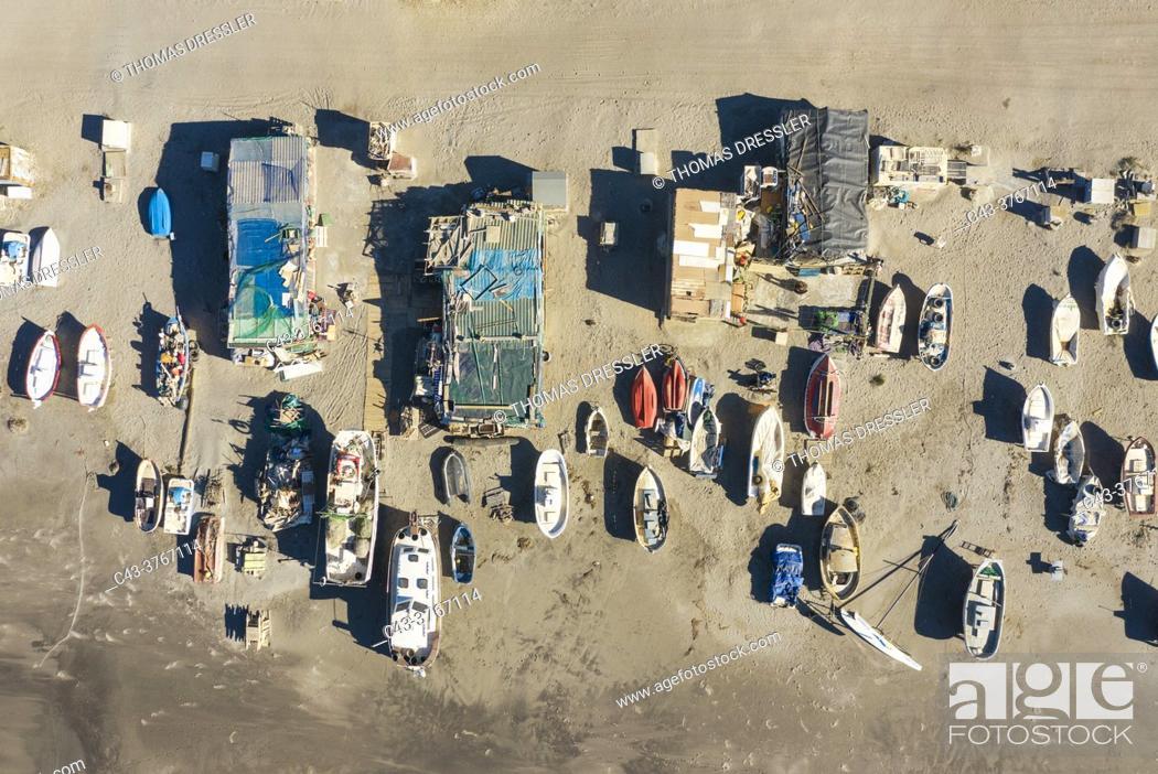Stock Photo: Fishing boats and fishermen cottages at the beach of San Miguel de Cabo de Gata. Aerial view. Drone shot. Nature Reserve Cabo de Gata-Nijar, Almeria province.