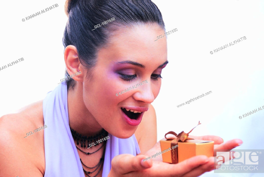 Stock Photo: Woman with a wrapped present.