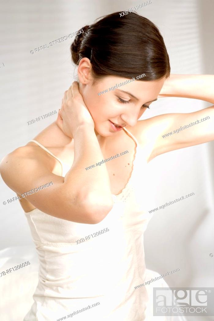 Stock Photo: young woman massaging neck.