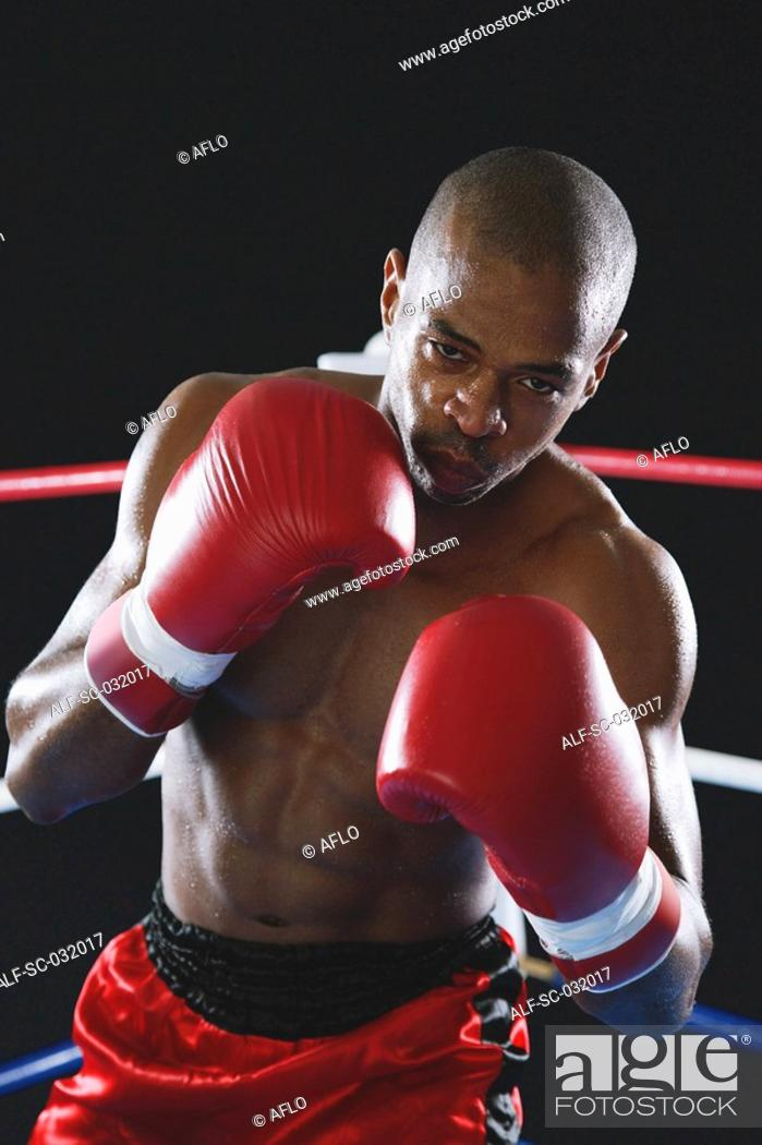 Stock Photo: African boxer wearing red Boxing gloves.