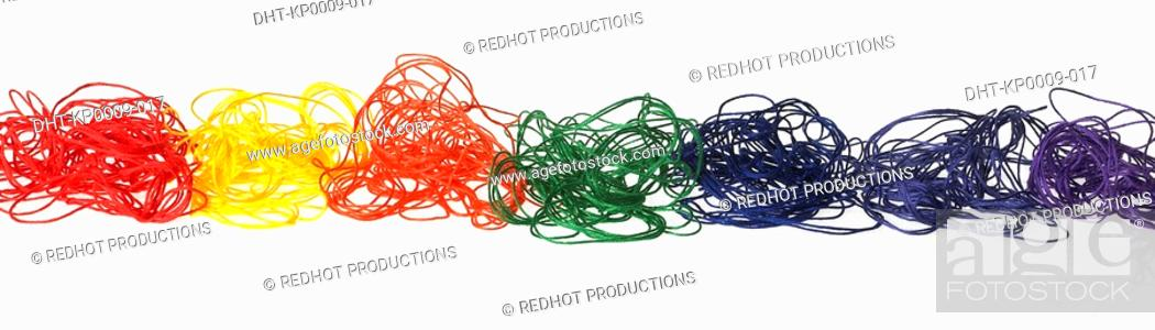 Stock Photo: Coloured threads in a row.