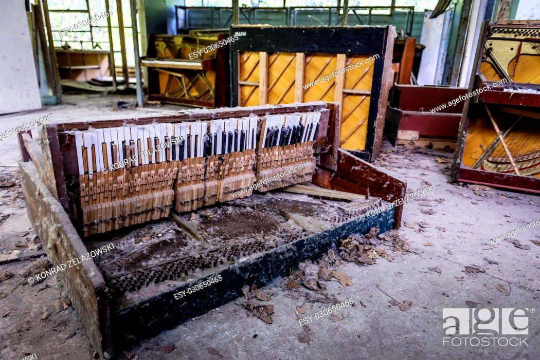 Stock Photo: Destroyed piano in abandoned music shop in Pripyat ghost city of Chernobyl Nuclear Power Plant Zone of Alienation in Ukraine.