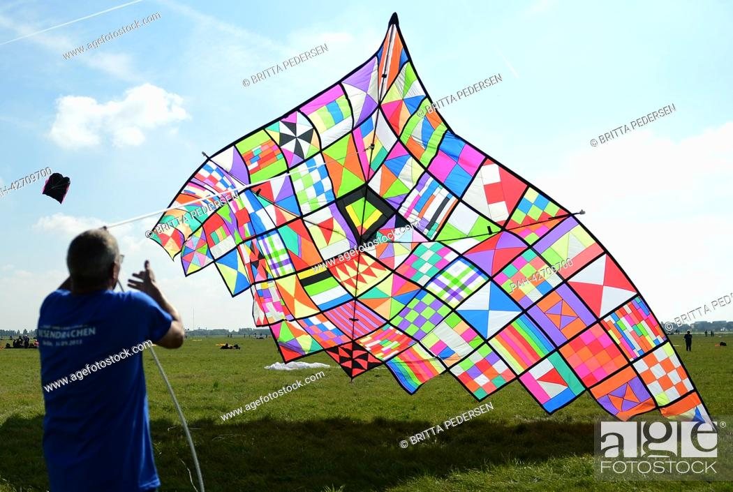 A man starts a giant kite at the festival in Berlin, Germany