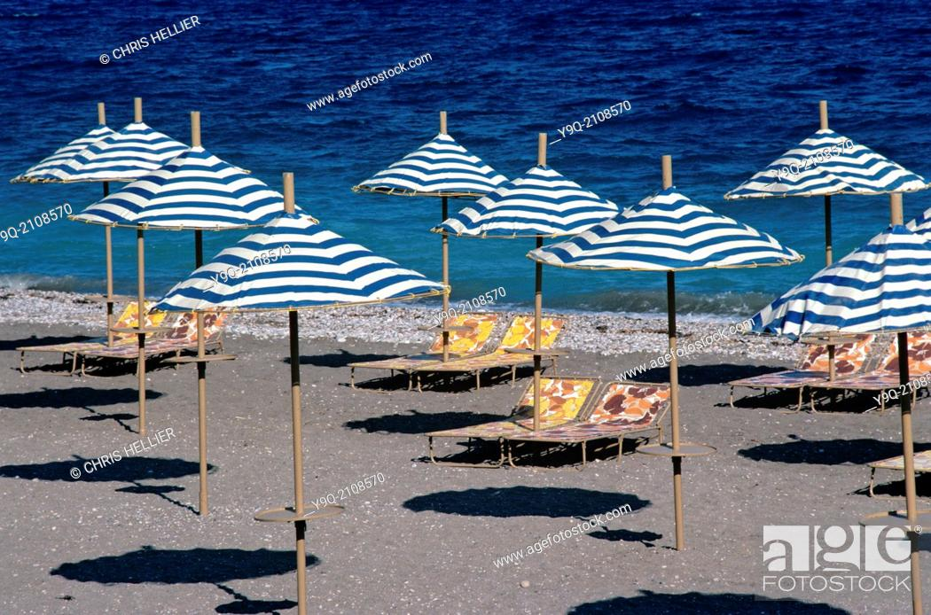 Stock Photo: Pattern of Parasols & Sunloungers on Deserted Beach Rhodes Greece.