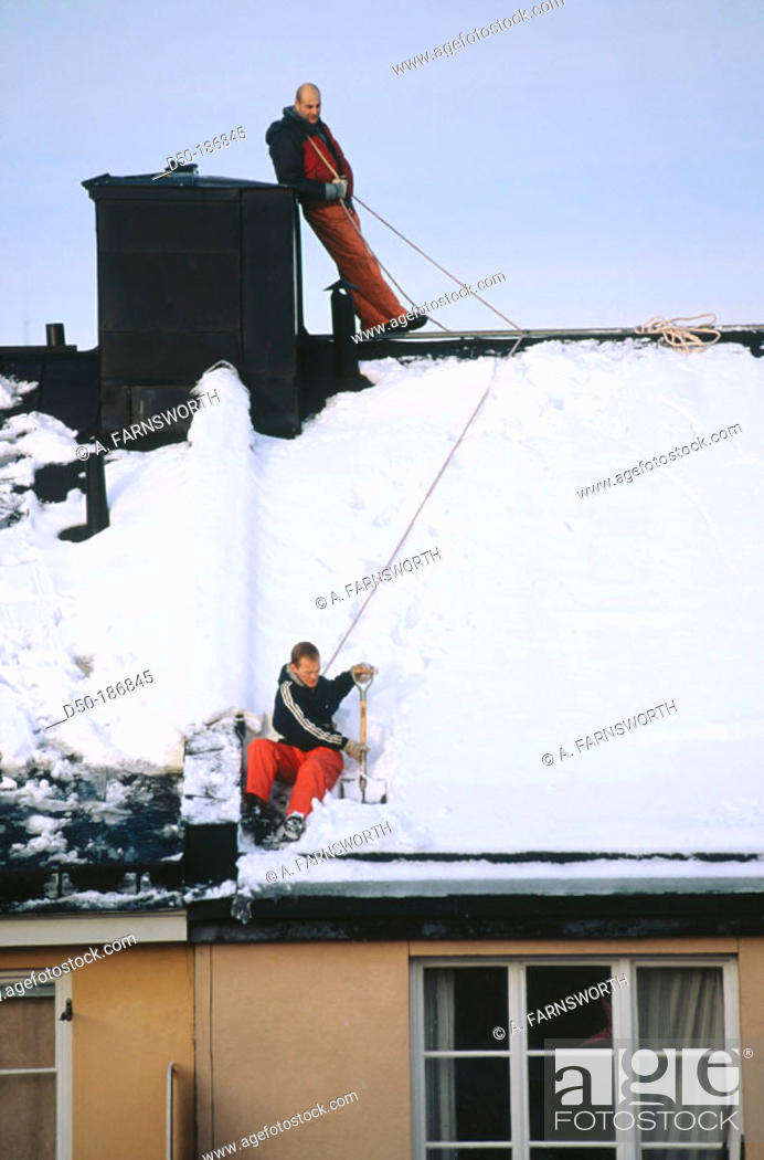 Stock Photo: Snow removal from roofs. Stockholm. Sweden.